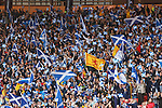 Scotland fans wave their Saltire flags before the match as the teams come out