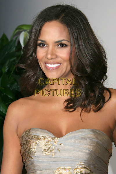 HALLE BERRY .Hosts the ESSENCE Black Women in Hollywood Luncheon held at The Beverly Hills Hotel, Beverly Hills, CA, USA, 19th February 2009..portrait headshot strapless gold silver patterned print metallic dress hair down teeth smiling .CAP/ADM/KB.©Kevan Brooks/Admedia/Capital PIctures