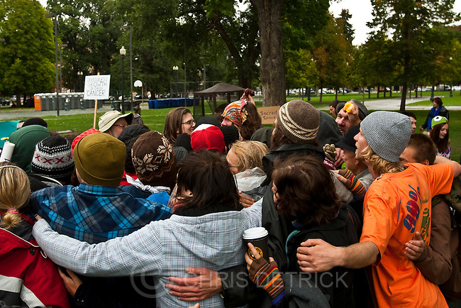 Chris Detrick  |  The Salt Lake Tribune.Occupy SLC participants have a group hug at Pioneer Park Friday October 7, 2011. The group opposes corporate greed and feels the government is out of touch with the people. They claim to be the 99 percent that has no voice.