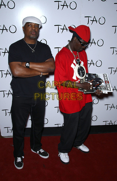 Public Enemy - Chuck D, Flavor Flav  .Worship Thursday with Public Enemy at Tao Nightclub inside The Venetian Las Vegas, NV, - Las Vegas, Nevada, USA..August 18th, 2011.group full length black red t-shirt sunglasses shades hat signing autographs jeans denim.CAP/ADM/MJT.© MJT/AdMedia/Capital Pictures.