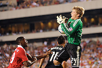 goalkeeper Brian Perk (24) of the Philadelphia Union miss handles a ball. Manchester United (EPL) defeated the Philadelphia Union (MLS) 1-0 during an international friendly at Lincoln Financial Field in Philadelphia, PA, on July 21, 2010.