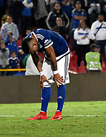 BOGOTA - COLOMBIA - 22 – 03 - 2018: Ayron del Valle, jugador de Millonarios, reacciona después de perder oportunidad de gol a Alianza Petrolera, durante partido aplazado de la fecha 8 entre Millonarios y Alianza Petrolera, por la Liga Aguila I 2018, jugado en el estadio Nemesio Camacho El Campin de la ciudad de Bogota. / Ayron del Valle, player of Millonarios reacts after missing opportunity to score goal to Alianza Petrolera, during a posponed match of the 8th date between Millonarios and Alianza Petrolera, for the Liga Aguila I 2018 played at the Nemesio Camacho El Campin Stadium in Bogota city, Photo: VizzorImage / Luis Ramirez / Staff.