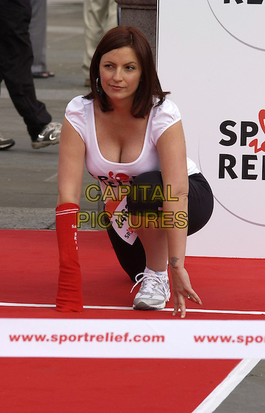 DAVINA McCALL.Launching Sport Relief in Trafalgar Square, London, UK. .May 3rd, 2006 .Ref: CAN.full length kneeling cleavage race.www.capitalpictures.com.sales@capitalpictures.com.©Capital Pictures