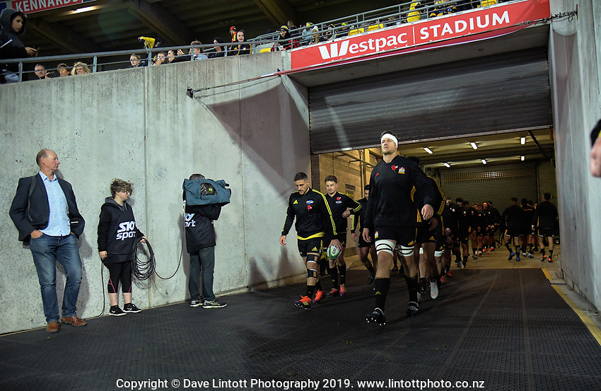 The teams walk out together for the Super Rugby match between the Hurricanes and Chiefs at Westpac Stadium in Wellington, New Zealand on Friday, 27 April 2019. Photo: Dave Lintott / lintottphoto.co.nz