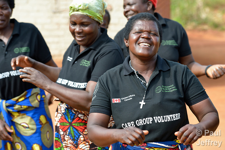 Members of a community care group sing a song about hygiene and the importance of hand washing in Kasangari Ngulube, Malawi. With support from the Ekwendeni Hospital AIDS Program, villagers here participate in a Building Sustainable Livelihoods program, working together to earn and save money, raise more nutritious food, receive vocational training, and promote better hygiene and health awareness.