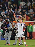 Landon Donovan acknowledges crowd following U.S. win. The United States won Group C of the 2010 FIFA World Cup in dramatic fashion, 1-0, over Algeria in Pretoria's Loftus Versfeld Stadium, Wednesday, June 23rd..