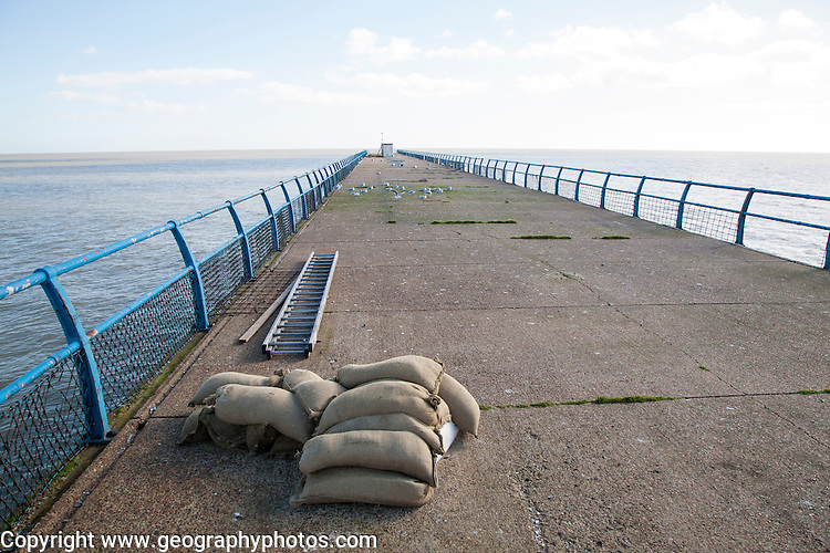 The disused pier jutting into the North Sea at Felixstowe, Suffolk, England