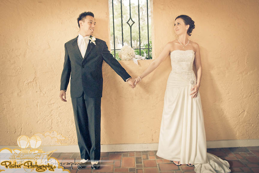 Desiree Peterlin and Nguyen Vu Dinh's wedding on Saturday, October 29, 2011 at St. Margaret Mary Catholic Church in Winter Park, Florida. They got ready at Desiree's mom's home in Winter Springs, the groom got ready at their home in Clermont, the reception took place at the Winter Park Civic Center and some photos were taken at Rollins College. (James Shaffer of http://www.PilsterPhotography.net)Desiree Peterlin and Nguyen Vu Dinh's wedding on Saturday, October 29, 2011 during a portrait session at Rollins College in Winter Park, Florida, The ceremony took place at St. Margaret Mary Catholic Church in Winter Park, Florida. The bride got ready at her mom's home in Winter Springs. The groom got ready at their home in Clermont, the reception took place at the Winter Park Civic Center and some photos were taken at Rollins College. (James Shaffer of http://www.PilsterPhotography.net)