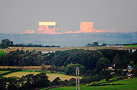 Heysham nuclear power station lit up in morning sun, Lancashire...Copyright..John Eveson, Dinkling Green Farm, Whitewell, Clitheroe, Lancashire. BB7 3BN.01995 61280. 07973 482705.j.r.eveson@btinternet.com.www.johneveson.com