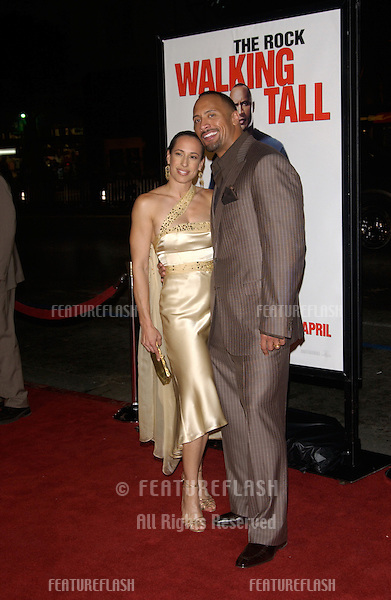 "DWAYNE ""THE ROCK"" JOHNSON & wife DANY GARCIA at the world premiere, in Hollywood, of his new movie Walking Tall..March 29, 2004"