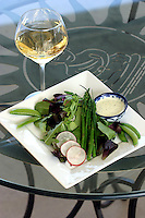 """Food and wine go together, but pairing them is an art in and of itself. This salad has been paired with Karma Vineyards Estate Gewurztraminer. The image was taken for """"Savoring Chelan"""" a 2010 recipe book about pairing wines with food."""