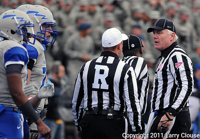 November 5, 2011:   Referee, David Epperley and Umpire, Jim Hyson, discuss a decision during a rivalry game between the Army Black Knights and the Air Force Falcons at Falcon Stadium, United States Air Force Academy, Colorado Springs, CO.  Air Force defeats Army 24-14 and retains the Commander-In-Chief's Trophy.