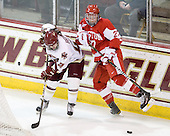 Kristina Brown (BC - 2), Tara Watchorn (BU - 27) - The Boston College Eagles defeated the Boston University Terriers 2-1 in the opening round of the Beanpot on Tuesday, February 8, 2011, at Conte Forum in Chestnut Hill, Massachusetts.