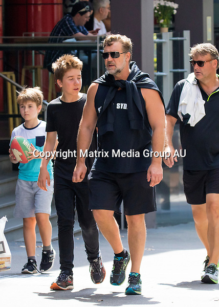 26 MARCH 2016 SYDNEY AUSTRALIA<br /> <br /> EXCLUSIVE PICTURES<br /> <br /> Russell Crowe pictured with his son's Charlie and Tennyson taking a walk around Woolloomooloo and Potts Point - at one point stopping off to pass the footy around and do some push ups.