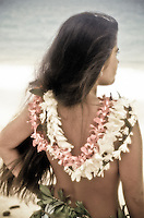 Girl with a lei on at the beach