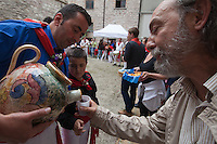 Europe,Italy,Umbria,Gubbio,La Festa dei Ceri, tradition is one of the most exciting and unique in Europe and takes place in the city of Gubbio May 15 of each year. The candles are three wooden machines in the form of octagonal prisms and decorated, weighing about 4 tons, carried triumphantly on the shoulders of ceraioli in honor of St. Ubaldo, the patron saint of the city.Along tha day in the privat courts people ofer everybody wine and traditional sweet cakes