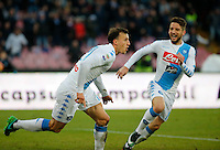 Vlad Chirechesc celebrates with Dries Mertens after scoring during the  italian serie a soccer match,between SSC Napoli and Torino       at  the San  Paolo   stadium in Naples  Italy , December 18, 2016
