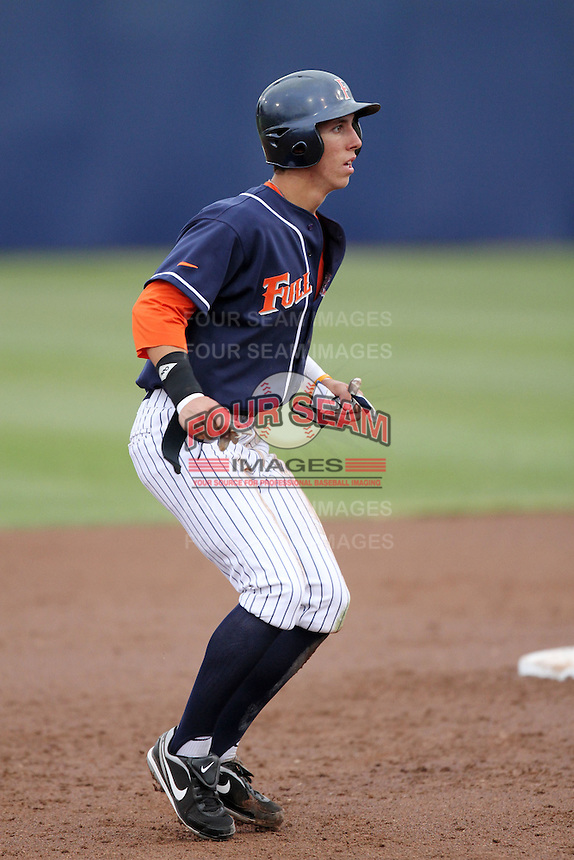 Michael Lorenzen #55 of the Cal. St. Fullerton Titans runs the bases against the Cal. St. Long Beach 49'ers at Goodwin Field in Fullerton,California on May 14, 2011. Photo by Larry Goren/Four Seam Images