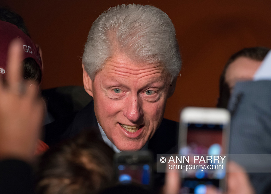 Elmont, New York, USA. April 5, 2016. Former President Bill Clinton, posing for cell phone photos after his speech, campaigns at an Organizing Event in Elmont, Long Island, on behalf of his wife, Hillary Clinton, the leading Democratic presidential candidate, and former Secretary of State and U.S. Senator for New York. The New York Democratic Primary takes place April 19th.