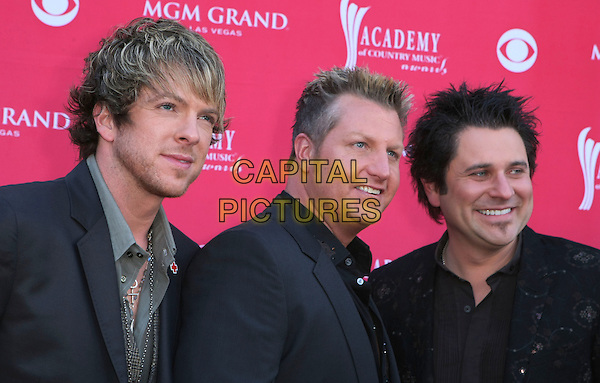 JOE DON ROONEY, GARY LeVOX & JAY DeMARCUS of Rascal Flatts.The 43rd Annual Academy of Country Music Awards (ACM) held at MGM Grand Garden Arena, Las Vegas, Nevada, USA..May 18th, 2008.headshot portrait black .CAP/ADM/MJT.© MJT/AdMedia/Capital Pictures.