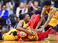 Washington, DC - August 17, 2018: Washington Mystics forward Aerial Powers (23) Los Angeles Sparks guard Alana Beard (0) and Los Angeles Sparks Nneka Ogwumike (30) fight for a loose ball late in the fourth quarter of game between the Washington Mystics and Los Angeles Sparks at the Capital One Arena in Washington, DC. (Photo by Phil Peters/Media Images International)