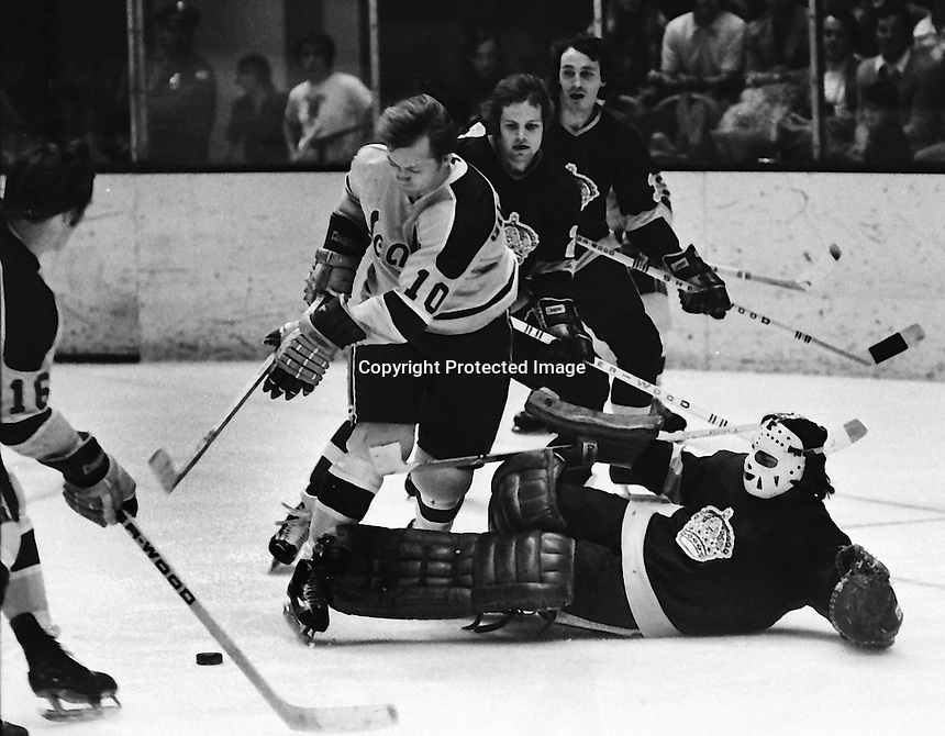 California Golden Seals action vs. LA Kings; Seals Stan Gilbertson in on goalie Rogie Vachon. (photo 1974 by Ron Riesterer)