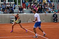Paris, France, 26 June, 2016, Tennis, Roland Garros, Mixed Doubles:  Jean-Julien Rojer (NED) and his partner Oksana Kalashnikova<br /> Photo: Henk Koster/tennisimages.com
