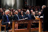 From left, President Donald Trump, first lady Melania Trump, former President Barack Obama, Michelle Obama, former President Bill Clinton, former Secretary of State Hillary Clinton, and former President Jimmy Carter listen as former Sen. Alan Simpson, R-Wyo., speaks during a State Funeral at the National Cathedral, Wednesday, Dec. 5, 2018, in Washington, for former President George H.W. Bush.<br /> Credit: Alex Brandon / Pool via CNP