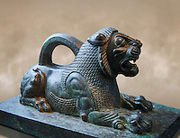 Bronze statuette of a Lion from the First Persian or Achaemenid Empire 6th to 5th cent. BC excavated from the Acropolis Susa, present day Iran.. The Louvre Museum, Paris.