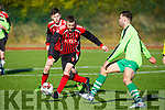 Conor Digging from  AC Athletic keeps an eye on the ball as Killarney Celtic's Vurasin Ocic pushes forward in the game in Mounthawk Park on Sunday last