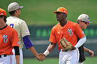 Center fielder Kyle Lewis (20) of the Mercer Bears shakes hands after winning a SoCon Tournament game against Western Carolina on Saturday, May 28, 2016, at Fluor Field at the West End in Greenville, South Carolina. Mercer won, 9-8. (Tom Priddy/Four Seam Images)