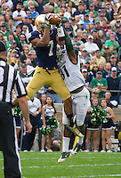 Irish wide receiver TJ Jones (7) catches a touchdown pass as Michigan State Spartans cornerback Darqueze Dennard (31) defends in the second quarter