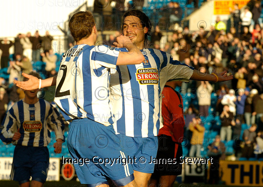 12/03/2005         Copyright Pic : James Stewart.File Name : jspa11_kilmarnock_v_dundee_utd.DANNY INVINCIBLE IS CONGRATULATED BY JAMES FOWLER AFTER HE SCORES KILMARNOCK'S THIRD......Payments to :.James Stewart Photo Agency 19 Carronlea Drive, Falkirk. FK2 8DN      Vat Reg No. 607 6932 25.Office     : +44 (0)1324 570906     .Mobile   : +44 (0)7721 416997.Fax         : +44 (0)1324 570906.E-mail  :  jim@jspa.co.uk.If you require further information then contact Jim Stewart on any of the numbers above.........A