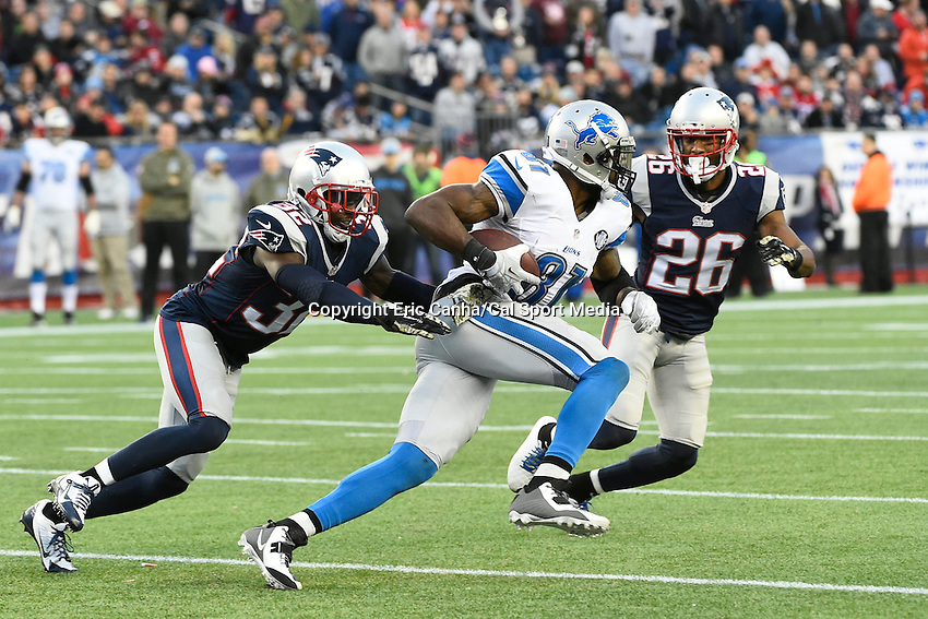 November 23, 2014 - Foxborough, Massachusetts, U.S.- New England Patriots free safety Devin McCourty (32) and cornerback Logan Ryan (26) team up to bring down Detroit Lions tight end Brandon Pettigrew (87) during the NFL game between the Detroit Lions and the New England Patriots held at Gillette Stadium in Foxborough Massachusetts. The Patriots defeated the Lions 34-9. Eric Canha/CSM