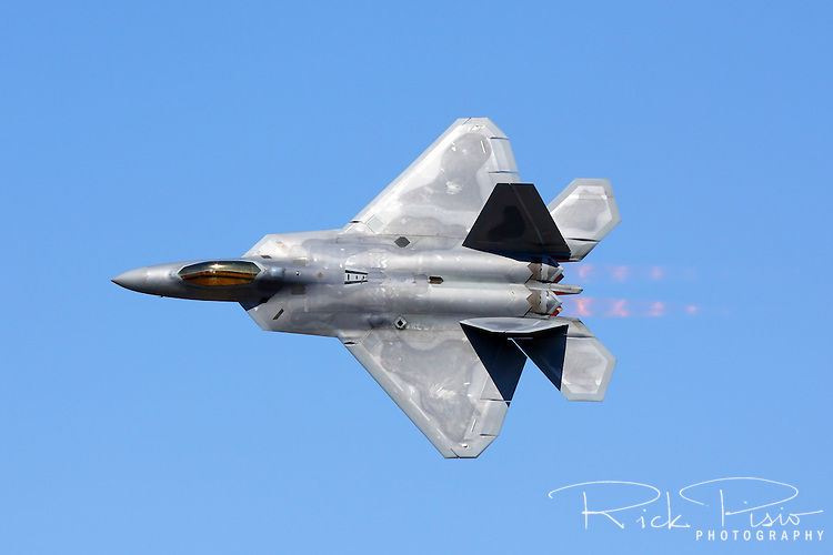 "United States Air Force pilot  Major Paul ""Max"" Moga, flying the F-22 Raptor, makes a pass in afterburner as part of an airpower demonstration during the 2008 Reno National Championship Air Races at Stead Field in Nevada."