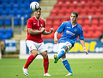 St Johnstone v York City...19.07.14  <br /> Gareth Rodger clears from Jake Hyde<br /> Picture by Graeme Hart.<br /> Copyright Perthshire Picture Agency<br /> Tel: 01738 623350  Mobile: 07990 594431