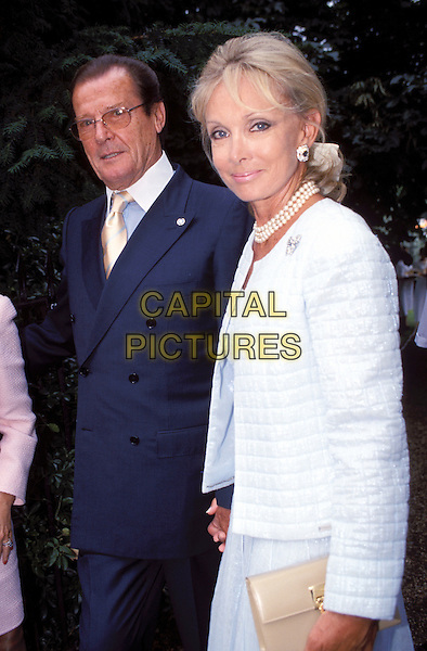 ROGER MOORE & WIFE.Ref: 9823.www.capitalpictures.com.sales@capitalpictures.com.© Capital Pictures