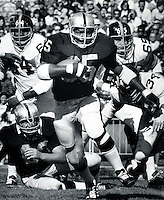 Raider back Hewritt Dixon runs for 1st down. 1969.copyright Ron Riesterer 1969