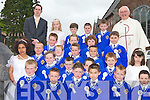 COMMUNION: Students of C.B.S. Cloun na Og making their First Holy Communion at St John Church on Saturday with their teacher Mr Riordan and Monsieur Dan Riordan.   Copyright Kerry's Eye 2008