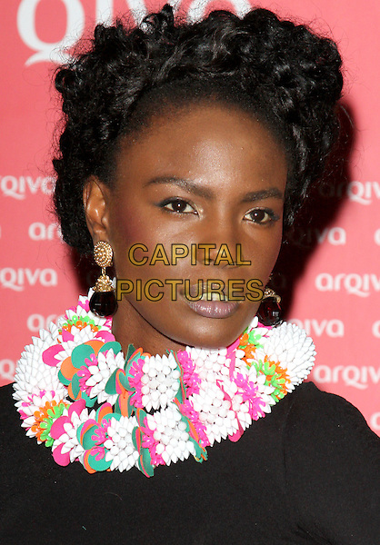 Shingai Shoniwa of The Noisettes.The Arqiva Commercial Radio Awards, Park Plaza Westminster Bridge Hotel, Westminster Bridge, London, England..July 4th, 2012.headshot portrait pink black white beads beaded necklace .CAP/ROS.©Steve Ross/Capital Pictures.