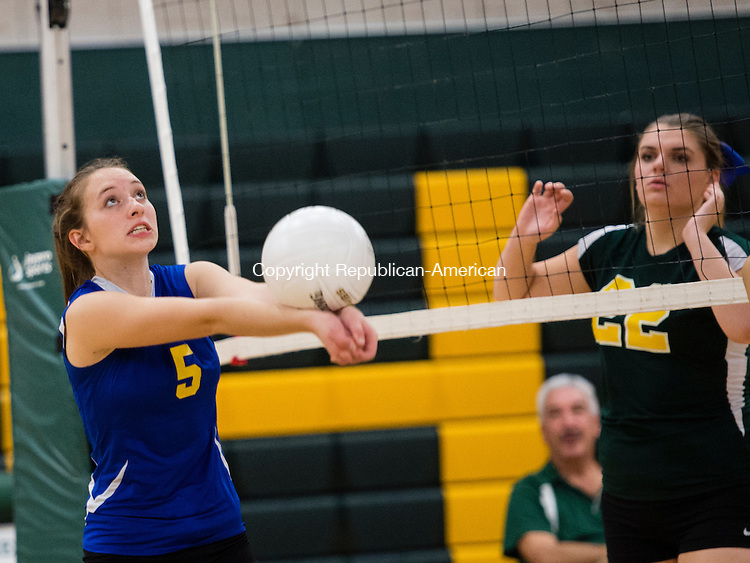 WATERBURY, CT- 27 October 2015-102715EC06-  Housatonic's Brooke Olownia helps the ball across the net as Holy Cross' Brianna Cracco looks on. The Crusaders swept the matches at home Tuesday night. Erin Covey Republican-American