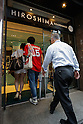 Hiroshima Carp baseball team fans enter to the Hiroshima Brand Shop TAU in Ginza on September 11, 2016, Tokyo, Japan. Hundreds of Carps fans lined up from early morning outside Hiroshima Brand Shop TAU to buy victory t-shirts after Hiroshima baseball team got its first Central League title in 25 years after beating the Yomiuri Giants 6-4 on Saturday, September 10. (Photo by Rodrigo Reyes Marin/AFLO)