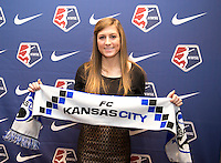 #5 overall pick Kasey Kallman of FC Kansas City poses with her team scarf during the NWSL draft at the Pennsylvania Convention Center in Philadelphia, PA, on January 17, 2014.