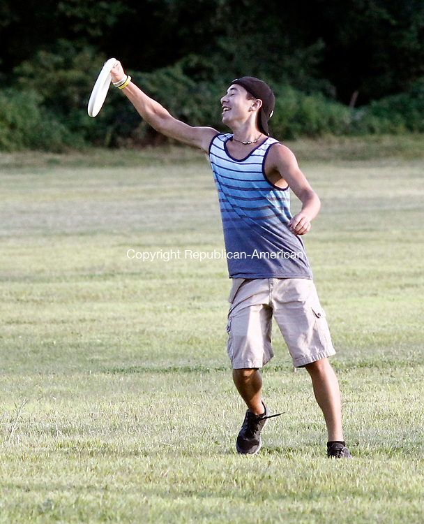 Woodbury, CT- 14 August 2014-081414CM09-  COUNTRY LIFE ONLY PLEASE-----  Tom Rosato of Woodbury catches the frisbee during the Town of Woodbury  Park and Recreation Ultimate Frisbee Club at Woodbury Strong Preserve on Thursday. The game which combines a football field, a Frisbee, and tactics similar to basketball is played weekly at the field.  The group is always seeking new members.  For more information call the park department at 203-263-3113. Christopher Massa Republican-American