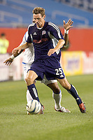 In the first half, Steve Ralston (Revolution) beats Jose Burciaga Jr. (Wizards). The Kansas City Wizards defeated the NE Revolution, 2-1, on August 6 at Gillette Stadium.