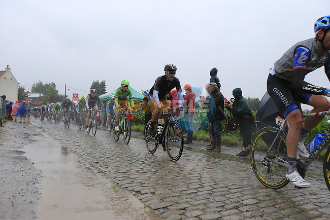 Riders including Jack Bauer (NZL) Garmin-Sharp and Fabian Cancellara (SUI) Trek Factory Racing tackle the1st cobbled sector 9 from Gruson to Crossroads de l'Arbe during Stage 5 of the 2014 Tour de France running 155.5km from Ypres to Arenberg. 9th July 2014.<br /> Picture: Eoin Clarke www.newsfile.ie