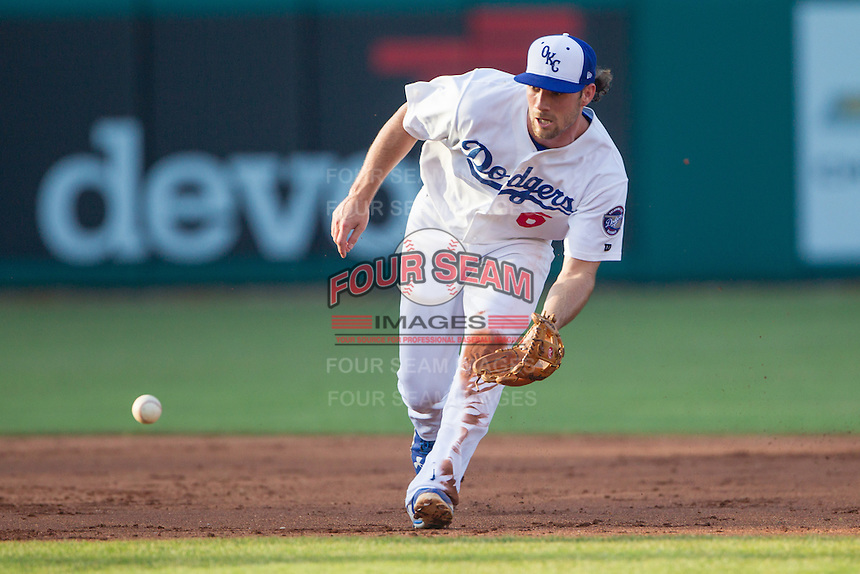 Oklahoma City Dodgers third baseman Charlie Culberson (6) goes after a ground ball during a game against the Omaha Storm Chasers at Chickasaw Bricktown Ballpark on June 16, 2016 in Oklahoma City, Oklahoma. Oklahoma City defeated Omaha 5-4  (William Purnell/Four Seam Images)