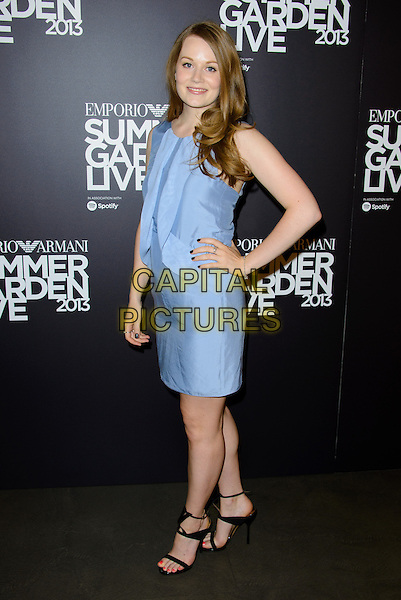 Cara Theobald<br /> Emporio Armani Summer Garden Live, London, England.<br /> 16th July 2013<br /> full length blue dress hand on hip<br /> CAP/CJ<br /> &copy;Chris Joseph/Capital Pictures