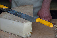 A wheel of Beaufort Cheese being cut at the Beaufort Dairy, September 2007