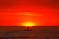 May 15, 2014 - San Diego, California, USA - MICHAEL LESTER paddle boards at La Jolla Shores Beach as smoke from recent  San Diego County wildfires fills the air creating an orange sunset.  (Photo Credit: © K.C. ALFRED/ZUMA PRESS)